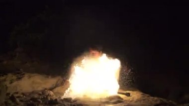 Skilled fire performer breaths fire towards camera, slow motion (240 fps) — Stock Video