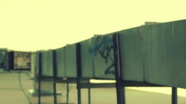 Pan from graffiti wall man jumps off wall — Stock Video