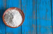 Bowl of wheat flour on vintage wood table from above. Rustic background with free text space. — Stock Photo