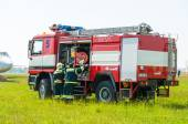 BORYSPIL, UKRAINE - MAY, 20, 2015: Firefighter lifted the Red hose after training put off the fire at Boryspil International Airport, Kiev, Ukraine. — Stock Photo
