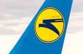 KIEV, UKRAINE - JULY 10, 2015: Aircraft Tail with logo sign of Ukraine international airlines in Borispol Airport — Stock Photo