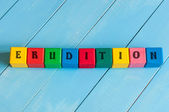 Word Erudition on childrens colourful cubes or blocks - educational background for teaching. — Stock Photo