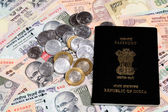 Passport on Indian rupee notes — Stock Photo