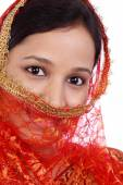 Beautiful young muslim woman against white  — Stockfoto