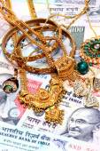 Closeup of gold ornaments on Indian currency — Stock Photo
