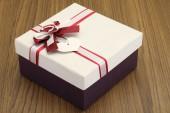 Beautiful gift box on wooden background  — Stock Photo