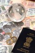 Indian currency with globe and passport — Stock Photo