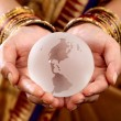Traditional woman hands holding a glass globe — Stock Photo #61350041