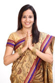 """Young traditional woman greeting """"Namasthe"""" — Stock Photo"""