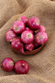 Red onions in a wooden bowl  — Stock Photo