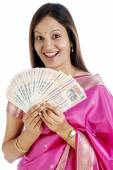 Young traditional woman holding Indian currency — Stock Photo