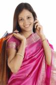Young Indian traditional woman with shopping bags  — Stock Photo