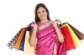Indian traditional woman with shopping bags — Stock Photo