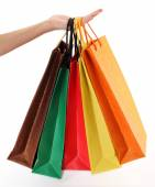 Colorful shopping bags set in woman's hand — Stock Photo