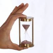 Woman hand holding a hourglass — Stock Photo