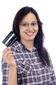 Happy young Indian girl holding credit card — Stock Photo