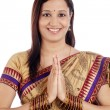 Young traditional Indian woman holding hands in prayer position  — Stock Photo #61446299