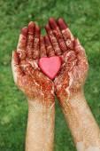 Heart shape in henna hands  — Stock Photo