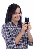 Happy Indian woman looking at mobile phone — Stockfoto