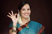 Traditional young Indian woman making OK sign — Foto de Stock