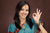 Beautiful young indian woman making OK sign — Foto de Stock