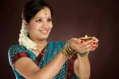 Young traditional woman holding diwali deepam — Stock Photo