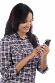 Young indian girl text messaging — Stock Photo