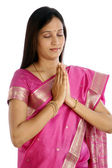 Young Indian woman doing prayer — Stock Photo