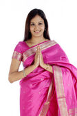 "Traditional woman greeting ""NAMASTE"" — Stock Photo"