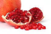 Ripe pomegranates on white — Stock Photo