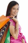 Young traditional woman holding shopping bags — Stock Photo