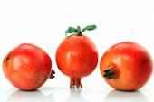 Ripe pomegranates with leaves — Stock Photo