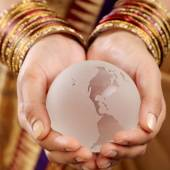 Glass globe in the hands — Stock Photo