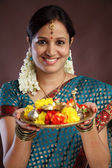 Smiling young traditional woman — Stock Photo