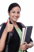 Successful female student with thumbs up — ストック写真