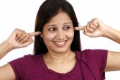 Young woman plugging ears with fingers — Foto Stock