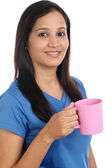 Young Indian woman with cup of coffee — Stock Photo