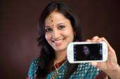 Traditiona young woman taking picture of herself — Stock Photo