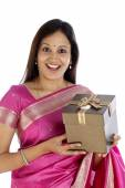 Surprised traditional woman holding gift box — Stock Photo