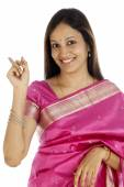 Young Indian woman showing back with her index finger — Stock Photo