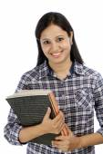 Smiling Indian female student against white — Stock Photo