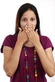Young woman with hands over mouth — Stock Photo