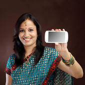 Smiling young traditional woman showing picture of herself — Stock Photo