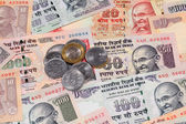 Indian rupee notes and coins — Stock Photo