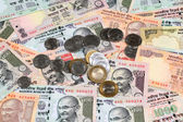 Indian currency notes and coins — Stock Photo