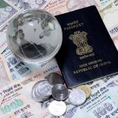 Indian currency with passport and glass glob — Stock Photo