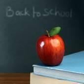 Red ripe apple on stack of books — Foto de Stock