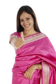 Young traditonal woman showing thumbs up — Stock Photo