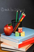 ABC cubes color pencils and red apple — Stock Photo