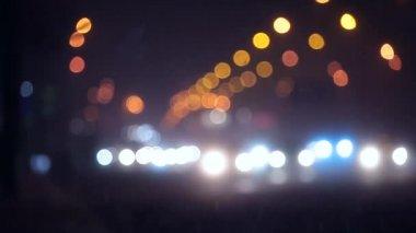 Snow defocused night traffic in city — Stock Video